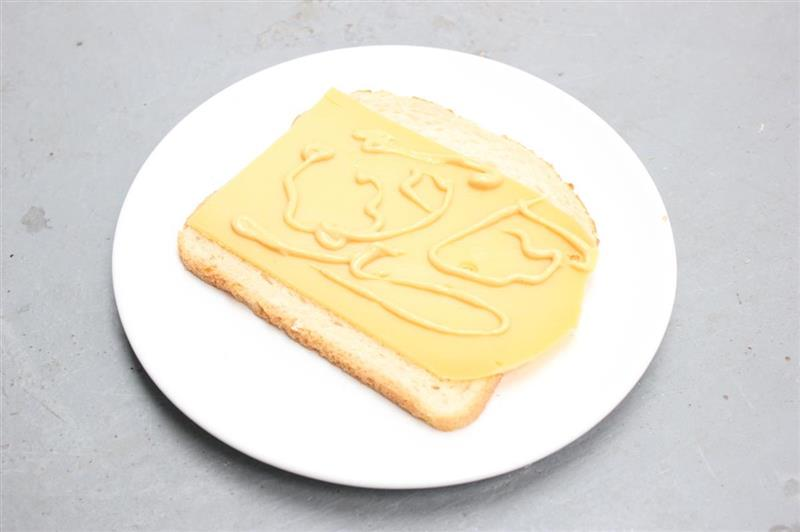 Painting on cheese on light brown bread, 2013